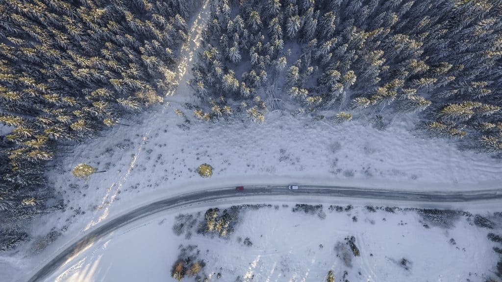 Photo of snowy road from above, downloaded from Pexels